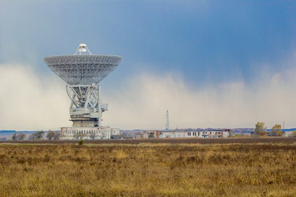 A large satellite dish points skyward
