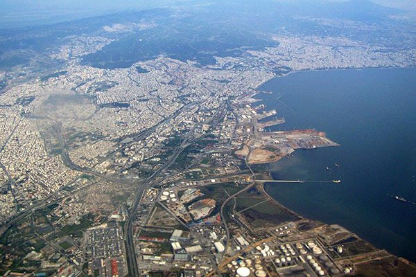 An aerial view of Thessaloniki with the ocean, mountains and city in view
