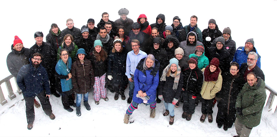 40 BlueHealth researchers gather in the snow for a photo