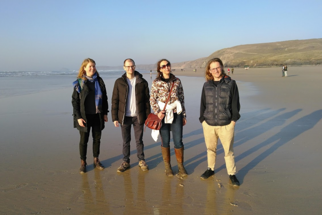 Asa (left) and James (right) explore Cornwall's Perranporth beach with fellow BlueHealth researchers