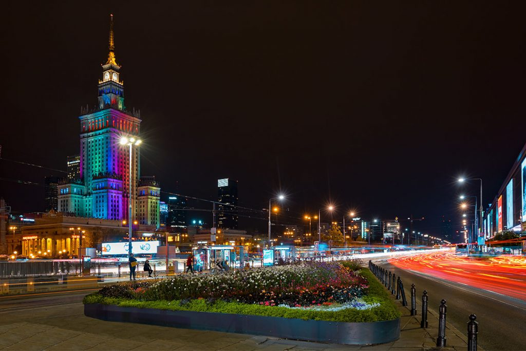 The modern city of Warsaw at night_Photo by Adam Nieścioruk on Unsplash