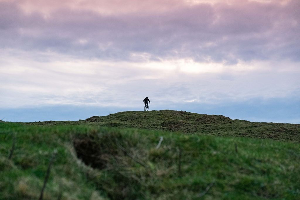 Photo of a cyclist looking out over the coast path at Crantock, Newquay