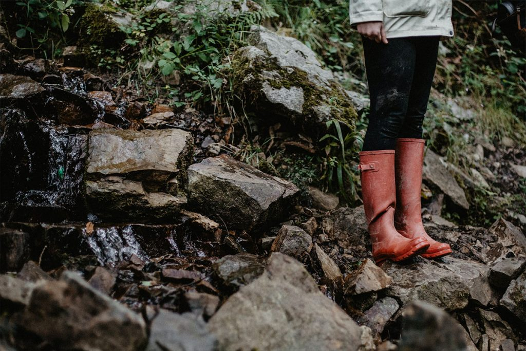 Person in wellies next to a stream
