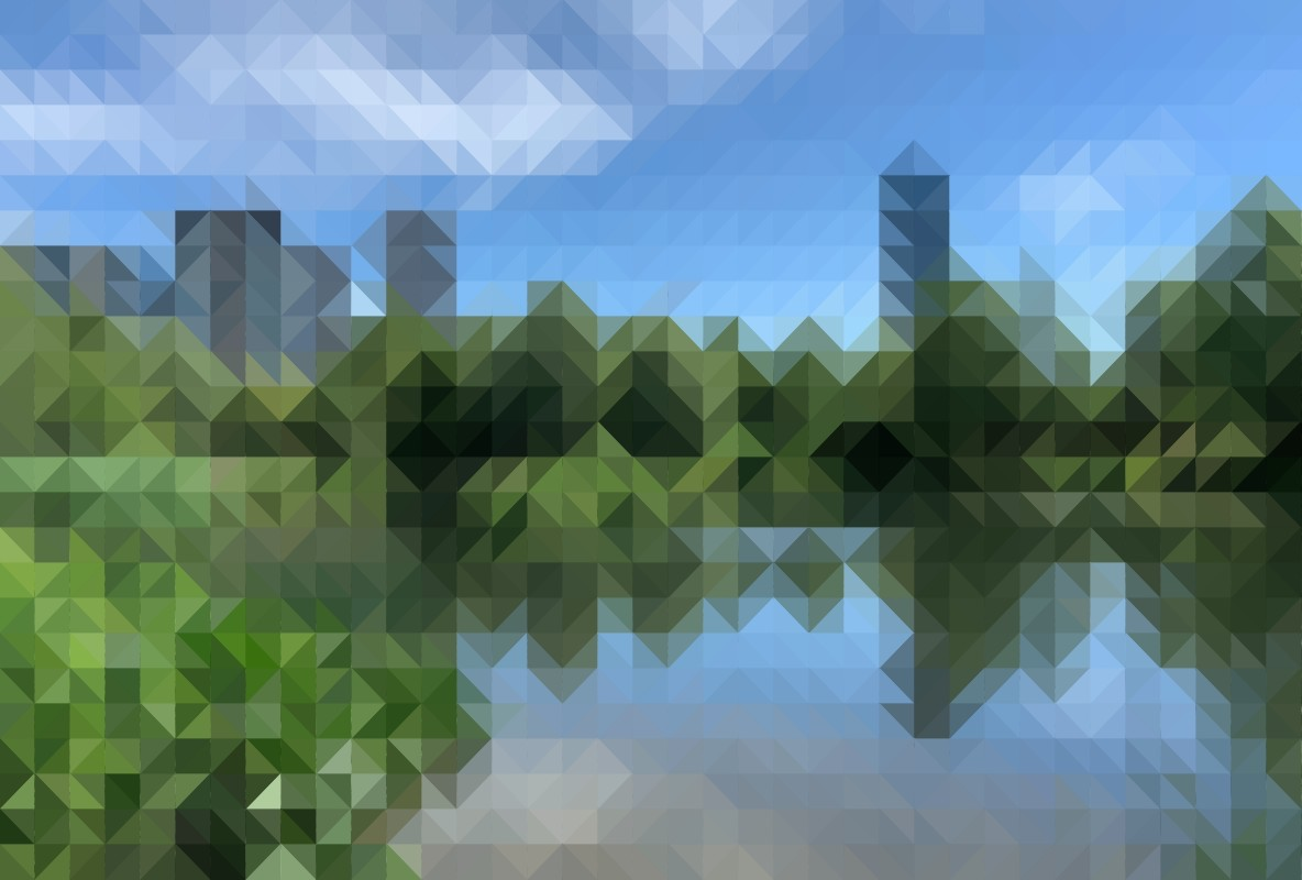 Image of a lake with trees and long grass, in front of tall city buildings